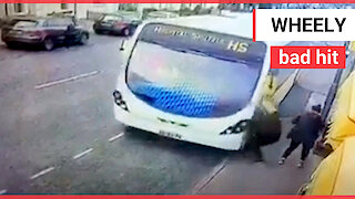 Shocking moment pedestrian gets hit by bus