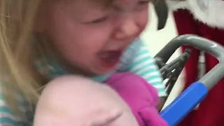 Baby Girl Gets Terrified Of Mechanical Dancing Santa - Video