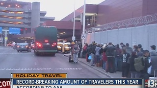 Holiday travelers congest roadways, swarm airport - Video