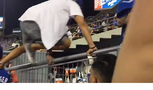 Fan Escorted From Dodger Stadium After Jumping into Bullpen - Video