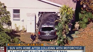 SUV hits home after crashing with motorcycle - Video