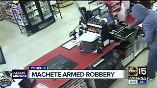 Masked suspect uses machete during Phoenix robbery - Video