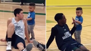 Coach's son does his part to get basketball team hyped