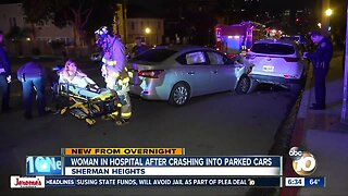 Woman hospitalized after crashing into parked cars