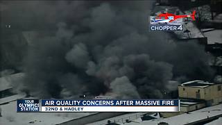 Milwaukee firefighters battle blaze at tire shop on north side - Video