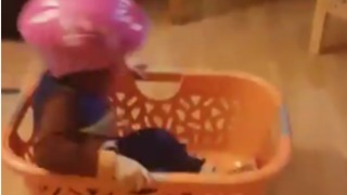 Innovative Three-Year-Old Recreates the Luge With Laundry Basket - Video