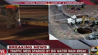Water main break causing traffic in Arcadia - Video
