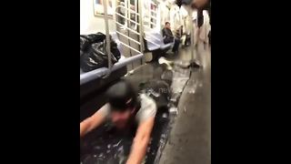 Pranksters use New York subway car to 'slip and slide' - Video