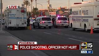 Phoenix Officers forced to shoot armed suspect who charged them - Video