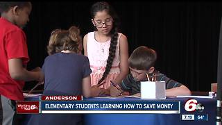 Bank teaches kids at Anderson Community Schools about saving money - Video
