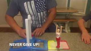 Father and Son Finally Get Gymnast Toy to Land on Its Feet - Video