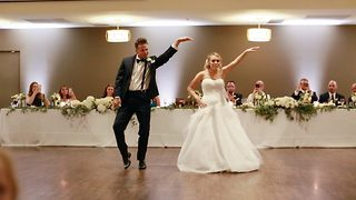 Couple let off canned heat as they mimic napoleon dynamite in first dance - Video