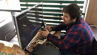 Brazen Lad Sets Up PS4 And Widescreen TV While eating McDonald's