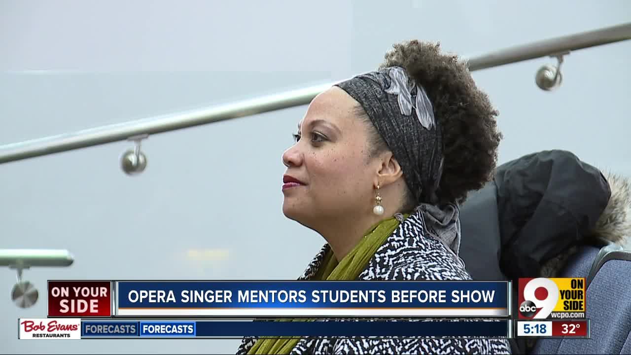 Opera singer mentors students before show