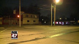 Police investigating overnight armed robbery in Lansing - Video