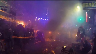 Festivalgoers Wear Helmets in Face of Fireworks Display - Video