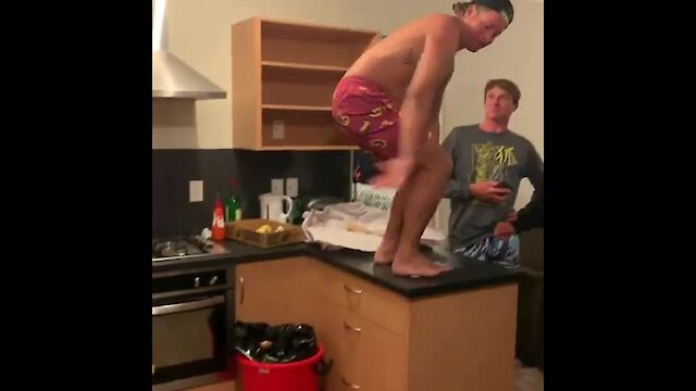 Dude does front-flip onto kitchen floor, acts like it's no big deal