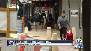 Food delivery workers brave rainy Labor Day