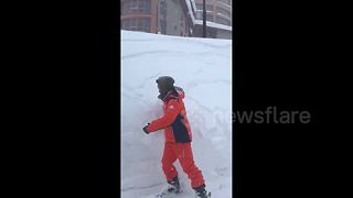 Skier creates 'mini-avalanche' in French Alps snow embankment - Video