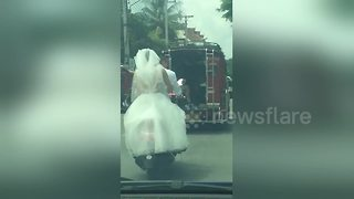 Bride riding pillion gets pulled over by police for not wearing helmet - Video