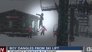 Crews rush to save little boy dangling from ski lift - Video