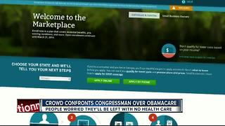 Crowd confronts congressman over Obamacare - Video
