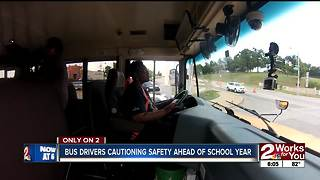 Bus drivers cautioning other drivers on the road - Video