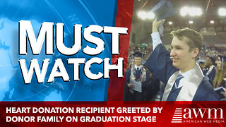 Heart donation recipient greeted by donor family on graduation stage - Video