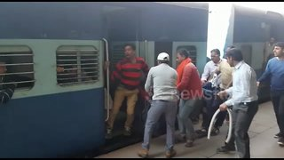 Terrifying moment passenger is saved from going under train - Video