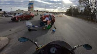 Cars collide right in front of motorcyclist