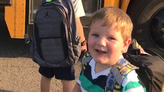 A Little Boy Trips And Falls Off A School Bus - Video