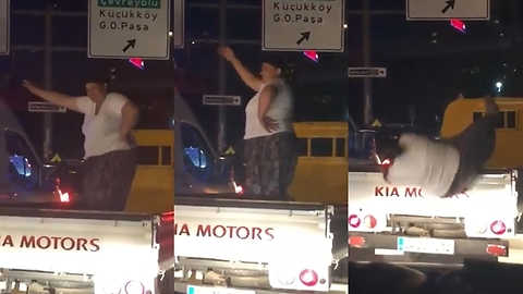 The woman falling dancing on the truck