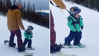 Sleepy boy takes a quick nap during snowboarding lessons