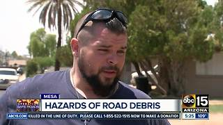 Motorcyclist hurt while dodging road debris