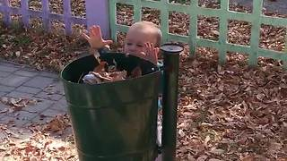 Toddler does his part by collecting trash