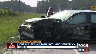 One injured in semi truck crash - Video