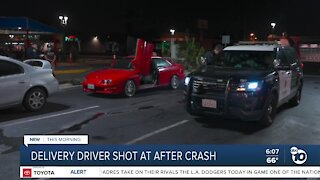 Delivery driver shot at after crash in Corridor area