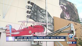 Artist painting King Kong mural in West Palm Beach