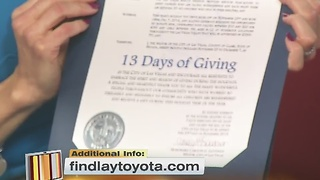 Oscar Goodman with a 13 Days of Giving proclamation for KTNV and Findlay Toyota