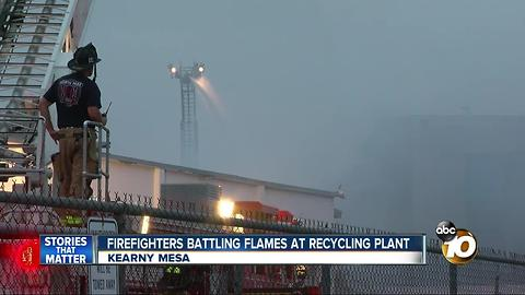 Firefighters working on flames at recycling plant