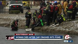 Car crashes into retention pond on city's SE side; woman pulled from water identified - Video