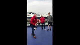 Road-tripping Liverpool fans play catch with replica Champions League trophy on ferry - Video