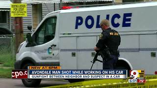 Man shot while working on his car - Video