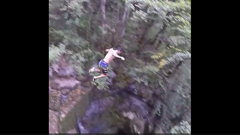Brave Daredevil Jumps Nearly 50 Feet Into Water Pit