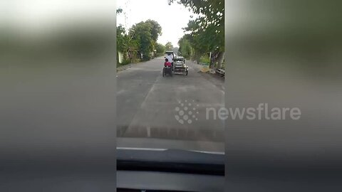 This is a wheel-y bad idea! Motorbike with sidecar pulls wheelchair on road in the Philippines