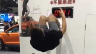 Man stops clock with insane backflip