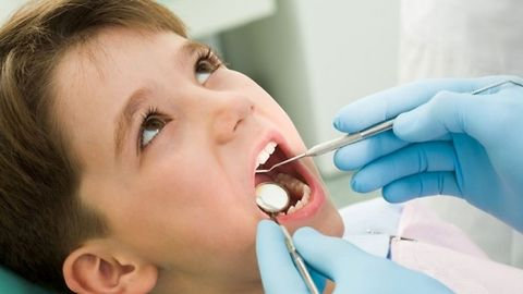 First filling for the 4 year old boy at the dentist.