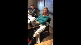 Woman kicked out of Starbucks after racist rant - Video
