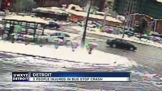 Three people in stable condition after car slams into Detroit bus stop on Woodward