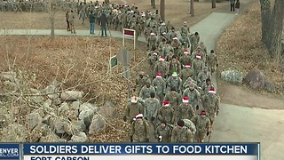 Soldiers deliver gifts to food kitchen